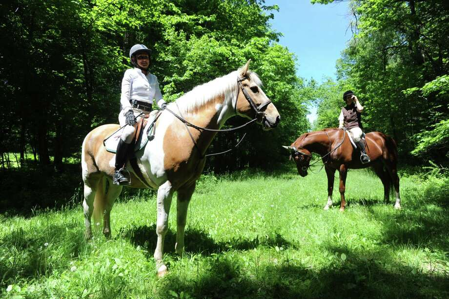 Horse riders that are members of the Greenwich Riding and Trails Association, ride at Nichols Preserve in Greenwich, Conn., Thursday, May 29, 2014. The Greenwich Riding and Trails Association is celebrating 100 years of the horse trail riding system. Photo: Bob Luckey / Greenwich Time