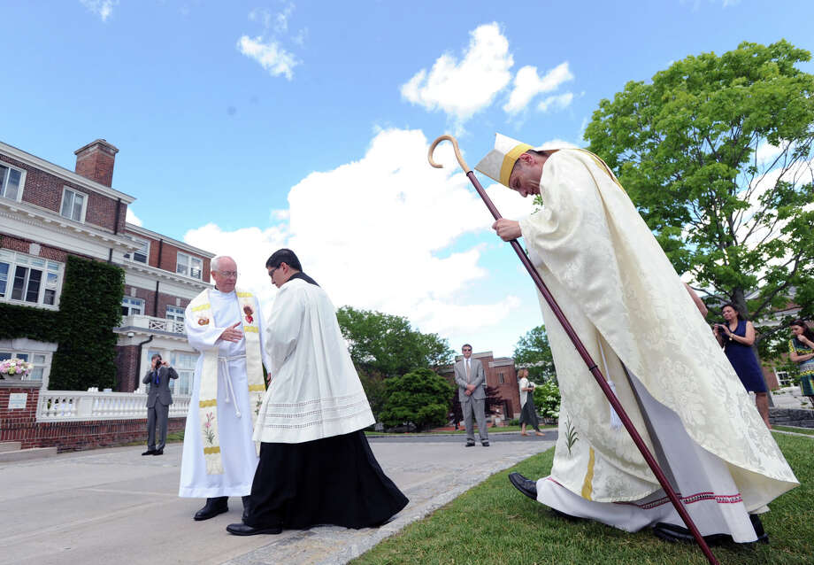 At right, Bishop Frank Caggiano during the Convent of the Sacred Heart Commencement at the school in Greenwich, Friday afternoon, June 6, 2014. Photo: Bob Luckey / Greenwich Time