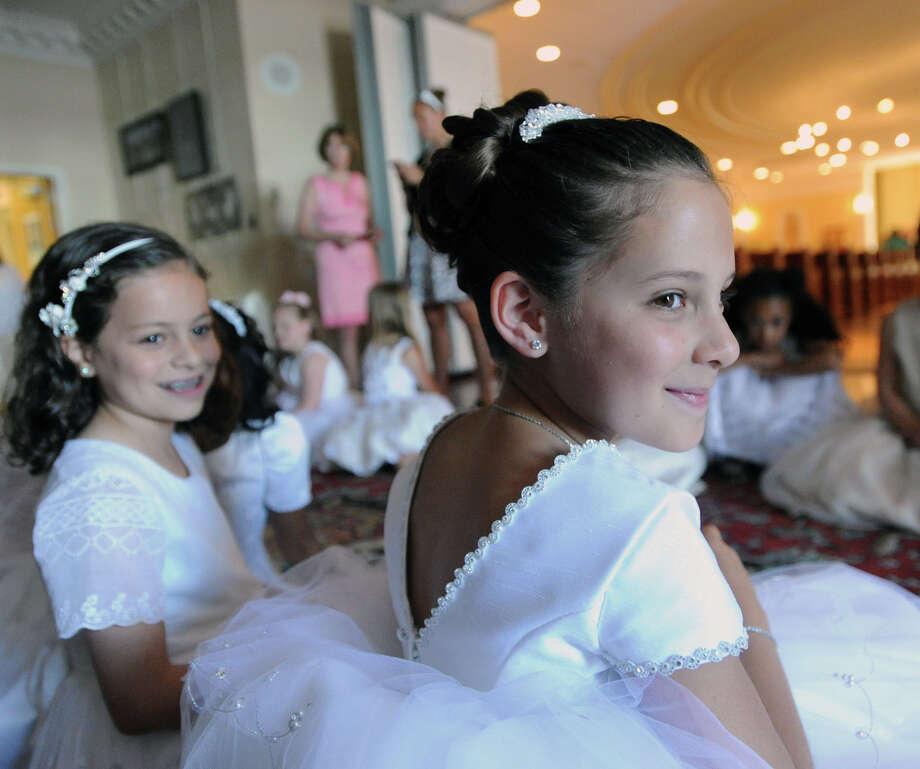 Flower girl Amanda Ciminello, 8, of Greenwich, a 2nd grade Convent student, during the Convent of the Sacred Heart Commencement at the school in Greenwich, Friday afternoon, June 6, 2014. Photo: Bob Luckey / Greenwich Time