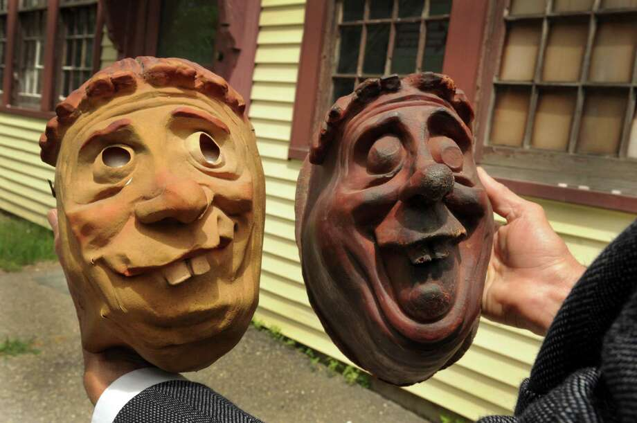 The former Topstone Rubber Company, in Bethel, Conn. made masks like the one left, held by Billy Michael of Bethel. Right is a mold similar to the mask. Both are owned by Michael. Friday, June 6, 2014. Photo: Carol Kaliff / The News-Times