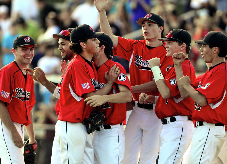 Fairfield Warde pitcher Reese Maniscalco, center left, walks off the field with his teammates celebrating its defeat of Trumbull, during baseball action in Trumbull, Conn. on Friday June 6, 2014. Photo: Christian Abraham / Connecticut Post