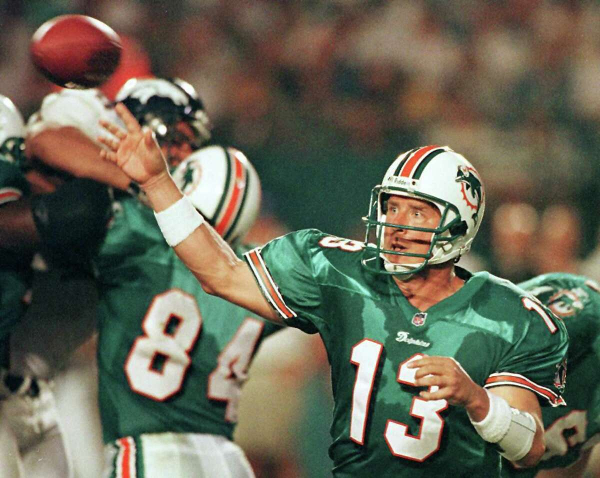 (FILES) In this December 21 1998 file photo, Miami Dolphins quarter back Dan Marino throws a pass during 4th quarter action against the Denver Broncos at Pro Player Stadium in Miami, Florida. Hall of Fame quarterback Dan Marino is among the latest group of NFL players to file a concussion-related lawsuit against the NFL. Marino and 14 other former NFL players filed the lawsuit in a federal court in Pennsylvania May 28, 2014 joining more than 4,500 others who had previously accused the NFL of misleading players about the long-term dangers of concussions. Marino has since withdrawn from the lawsuit. AFP PHOTO RHONA WISE / FILESRHONA WISE/AFP/Getty Images
