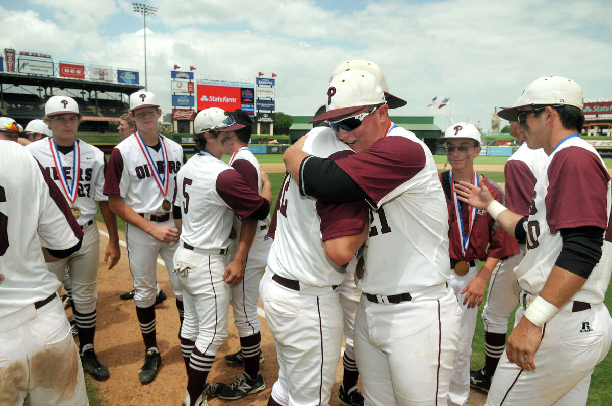 Pearland senior pitcher Jake Crain, center, shares a hug with teammate Casey Michna after the Oiler's 8-1 loss to Lewisville Flower Mound in their Class 5A UIL Baseball State Championships matchup at Dell Diamond in Round Rock on Friday.