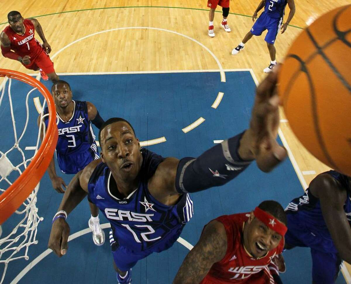 ARLINGTON, TX - FEBRUARY 14: Dwight Howard #12 of the Eastern Conference rebounds against Carmelo Anthony #15 of the Western Conference during the first half of the NBA All-Star Game, part of 2010 NBA All-Star Weekend at Cowboys Stadium on February 14, 2010 in Arlington, Texas. NOTE TO USER: User expressly acknowledges and agrees that, by downloading and or using this photograph, User is consenting to the terms and conditions of the Getty Images License Agreement. (Photo by Jed Jacobsohn/Getty Images) *** Local Caption *** Dwight Howard;Carmelo Anthony;Dwyane Wade
