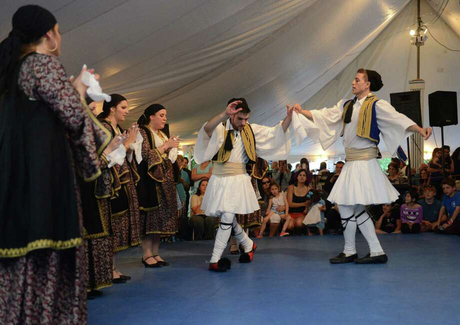 Yianni Koulouris, left, of New Milford, and Nick Agoras, of Danbury, perform a Greek dance with other members of the Levendia Dancers at The Greek Experience Festival 2014 at Assumption Greek Orthodox Church in Danbury, Conn. Friday, June 6, 2014.  The festival featured traditional Greek food and pastries, shopping, live music, and traditional dancing.  The Greek Experience continues Saturday from noon to 11 p.m. and Sunday from noon to 9 p.m. Photo: Tyler Sizemore / The News-Times