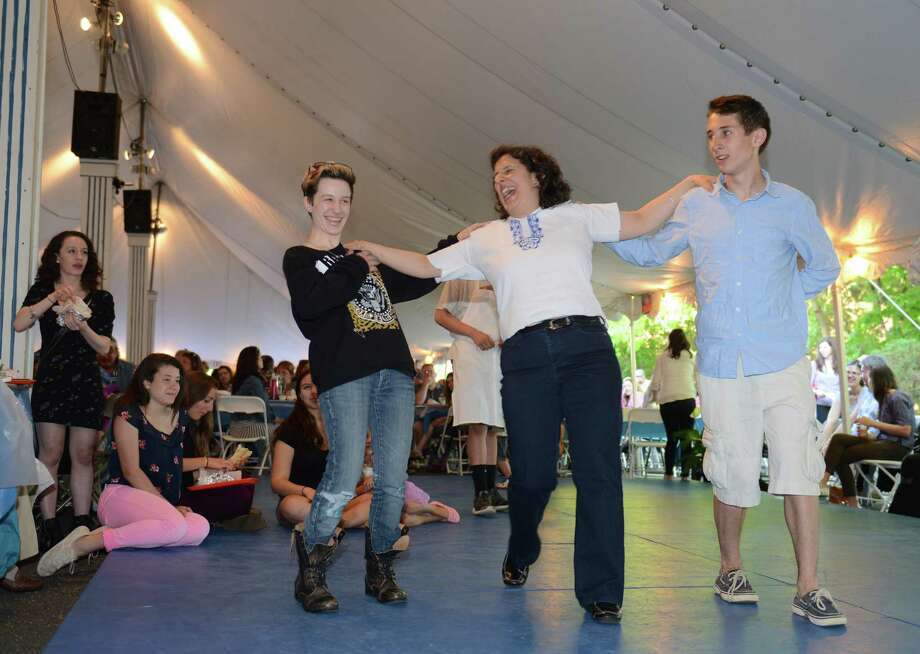 From left, Sophia Vendetti, 16, of New Milford, Anna Koulouris, of Kent, and John Russo, 15, of Bethel, dance on stage at The Greek Experience Festival 2014 at Assumption Greek Orthodox Church in Danbury, Conn. Friday, June 6, 2014.  The festival featured traditional Greek food and pastries, shopping, live music, and traditional dancing.  The Greek Experience continues Saturday from noon to 11 p.m. and Sunday from noon to 9 p.m. Photo: Tyler Sizemore / The News-Times