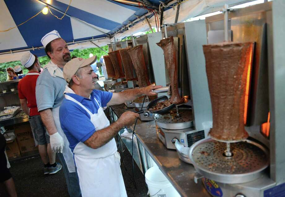 Peter Soumakis, left, of Patterson, N.Y., and Sprio Rountos, of Danbury, prepare a gyro at The Greek Experience Festival 2014 at Assumption Greek Orthodox Church in Danbury, Conn. Friday, June 6, 2014.  The festival featured traditional Greek food and pastries, shopping, live music, and traditional dancing.  The Greek Experience continues Saturday from noon to 11 p.m. and Sunday from noon to 9 p.m. Photo: Tyler Sizemore / The News-Times
