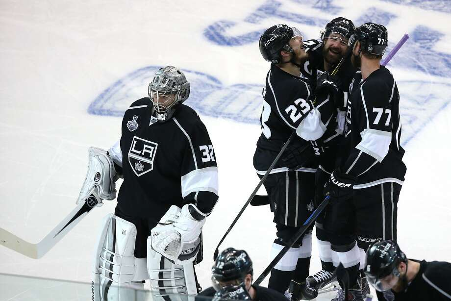 LOS ANGELES, CA - JUNE 04:  (C) Justin Williams #14 of the Los Angeles Kings and teammates Jonathan Quick #32, Dustin Brown #23 and Jeff Carter #77 celebrate Williams overtime game-winner against the New York Rangers as the Kings defeated the Rangers 3-2 during Game One of the 2014 NHL Stanley Cup Final at the Staples Center on June 4, 2014 in Los Angeles, California.  (Photo by Victor Decolongon/Getty Images) Photo: Victor Decolongon, Getty Images