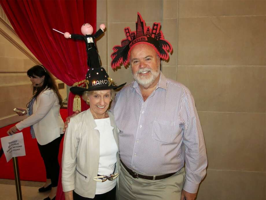 Former SFS President Nancy Bechtle, with Patrick Smith, wears a cowboy hat created for her by the late BBB creator Steve Silver Photo: Catherine Bigelow