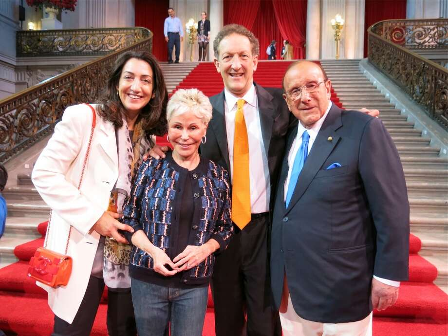 Pam Baer and her husband, Giants President Larry Baer with Jo Schuman Silver and her cousin, music mogul Clive Davis. Photo: Catherine Bigelow