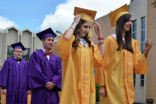 The 2014 graduates of Saratoga Central Catholic School march into St. Clement's Church for Commencement Exercises Friday, June 6, 2014, in Saratoga Springs, N.Y.  (John Carl D'Annibale / Times Union)