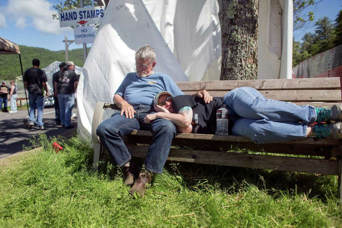 A couple takes a nap on a bench after a long day during the Americade motorcycle rally in Lake George, N.Y. on Friday, June 6, 2014. (Tom Brenner/ Special to the Times Union)