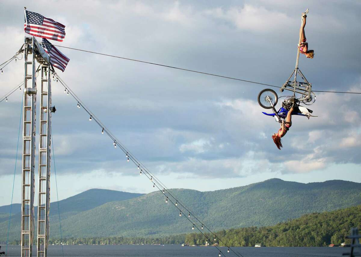 The Circus Una all women's group performs their motorcycle tightrope act during the Americade motorcycle rally in Lake George, N.Y. on Friday, June 6, 2014. (Tom Brenner/ Special to the Times Union)