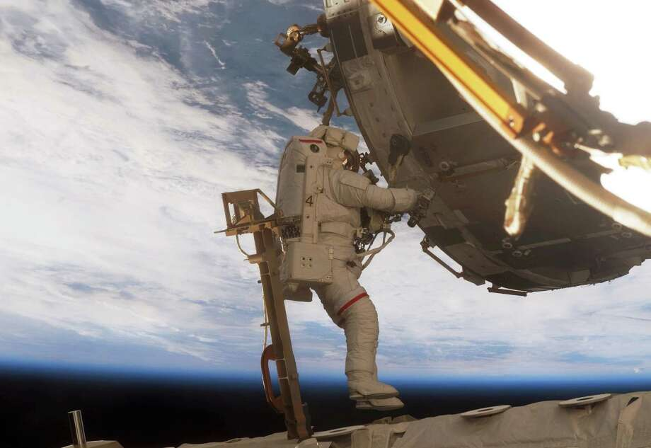 In this image made available by NASA, astronaut Scott Parazynski, STS-120 mission specialist, participates in the second of five scheduled sessions of extravehicular activity (EVA) as construction continues on the International Space Station, Sunday, Oct. 28, 2007. (AP Photo/NASA) / NASA