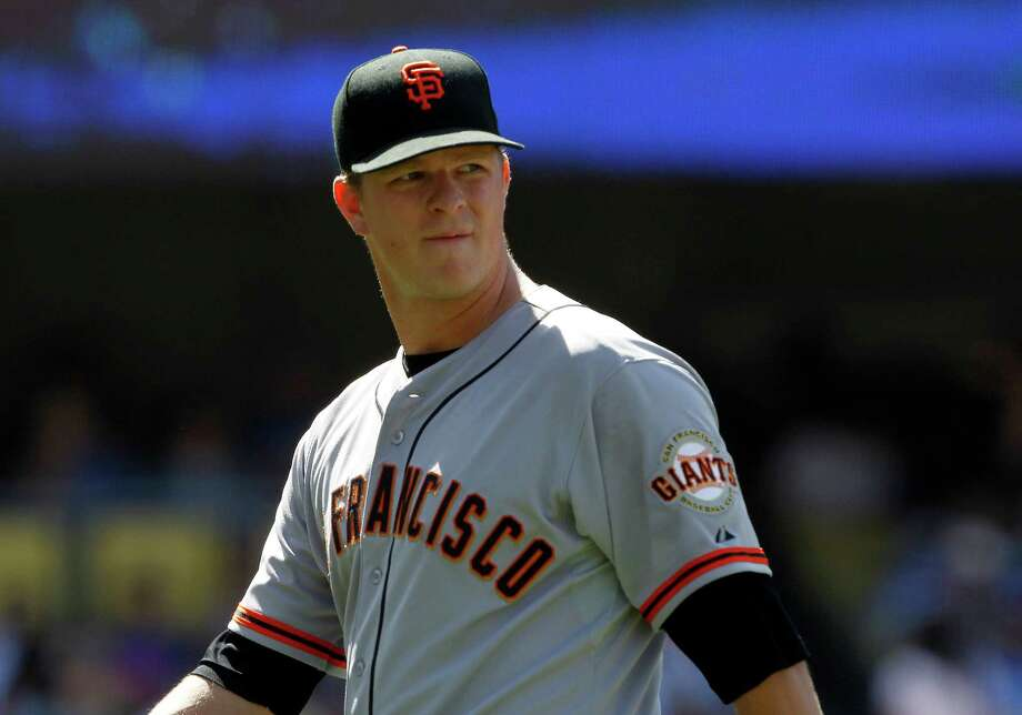 San Francisco Giants starting pitcher Matt Cain looks up at the score board walking back to the dugout after being removed in the sixth inning of a baseball game against the Los Angeles Dodgers on Saturday, May 10, 2014, in Los Angeles. (AP Photo/Alex Gallardo) Photo: Alex Gallardo, FRE / FR170211 AP