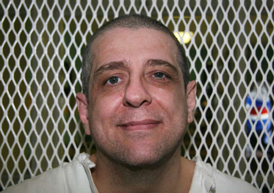 **ADVANCE FOR WEEKEND MARCH 20- 21** In this photo taken Dec. 16, 2009 is death row inmate Hank Skinner seen in the visiting area of the Texas Department of Criminal Justice's Polunksy Unit in West Livingston, Texas. Skinner, 47, convicted of a triple slaying in Pampa more than 16 years ago, is scheduled to die March 24, 2010 in Hunstville. (AP Photo/Michael Graczyk) Photo: Michael Graczyk, STF / AP