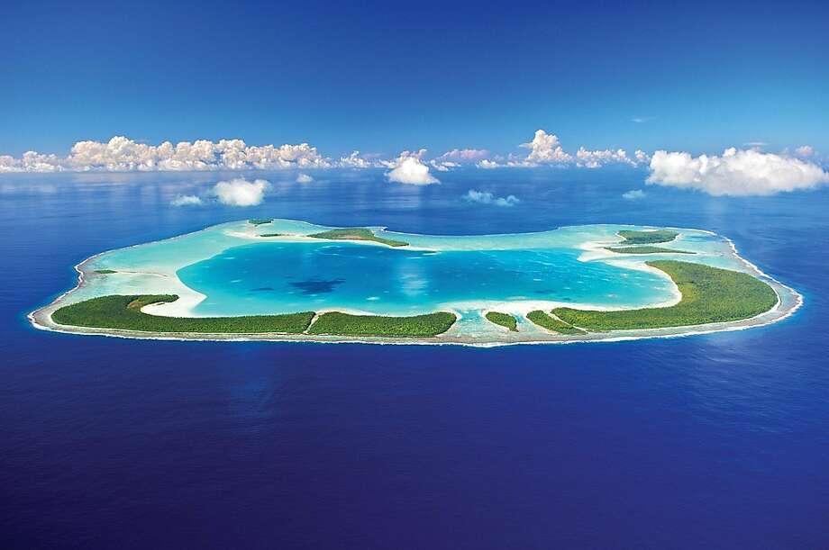 Marlon Brando's former retreat of Tetiaroa, an atoll 30 miles north of Tahiti, now hosts the Brando, a 35 villa, all-inclusive resort opening July 1. Photo: Tmk, Tmk