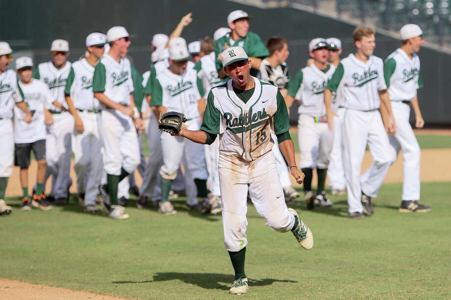 Reagan's Drew Brooks (15) and the rest of the team celebrate their 5-4 victory over Humble Atascocita in their UIL Class 5A state semi-final game at Dell Diamond in Round Rock on Friday, June 6, 2014.  MARVIN PFEIFFER/ mpfeiffer@express-news.net Photo: MARVIN PFEIFFER, Marvin Pfeiffer/ Express-News / Express-News 2014