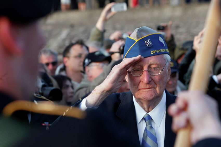 World War II veteran of the U.S. 29th Infantry Division, Morley Piper, 90, Mass., salutes during a D-Day commemoration, on Omaha Beach in Vierville sur Mer, western France , Friday June 6, 2014. Veterans and Normandy residents are paying tribute to the thousands who gave their lives in the D-Day invasion of Nazi-occupied France 70 years ago. (AP Photo/Thibault Camus) ORG XMIT: XTC108