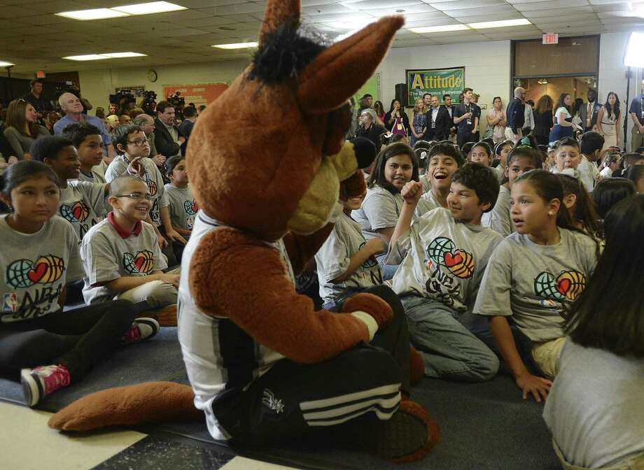 The Spurs Coyote entertains children at Bowden Elementary School during an event to open the new NBA Cares Learn and Play Center there. Photo: Billy Calzada / San Antonio Express-News / San Antonio Express-News