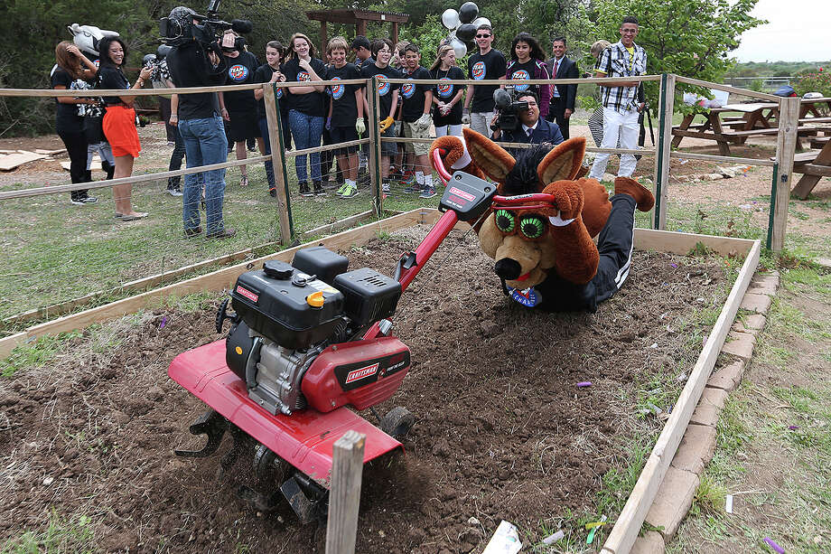 The San Antonio Spurs Coyote messes around with a tiller at Northeast ISD's Harris Middle School, Monday, April 14, 2014. Photo: Jerry Lara, San Antonio Express-News File Photo / ©2014 San Antonio Express-News