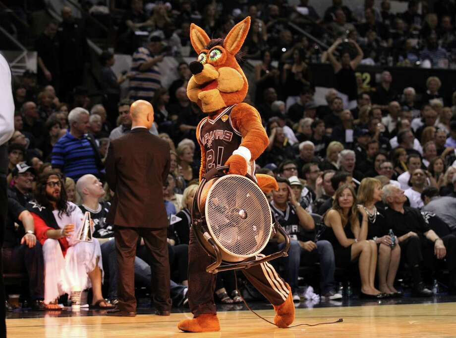 The Spurs Coyote carries a fan in reaction to the air condition failure in the facility during Game 1 of the 2014 NBA Finals at the AT&T Center on Thursday, June 5, 2014. Spurs defeat the Heat, 110-95. Photo: Kin Man Hui, San Antonio Express-News File Photo / ©2014 San Antonio Express-News