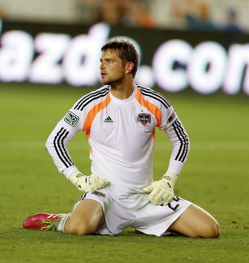 Houston Dynamo goalkeeper Tyler Deric (24) sits on the turf after Sporting KC scored a goal during the first half of the MLS soccer game at BBVA Compass Stadium, Friday, June 6, 2014, in Houston. Photo: Karen Warren, Houston Chronicle / © 2014 Houston Chronicle