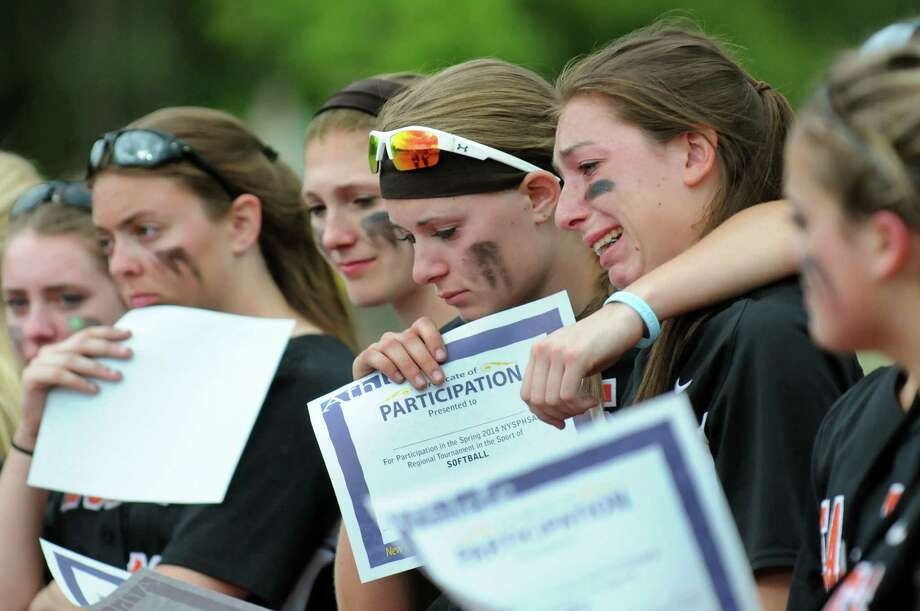 Bethlehem's KK Palmerino, center, puts an arm around teammate Meagan Sullivan as they take in their loss to Liverpool in their Class AA state softball quarterfinal on Friday, June 6, 2014, at the Luther Forest Athletic Fields in Malta, N.Y. (Cindy Schultz / Times Union) Photo: Cindy Schultz / 00027214A