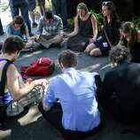 Seattle Pacific University students gather outside of Otto Miller Hall to pray the day after a gunman shot three people on campus, killing one. Many on the campus of the Christian school have turned to prayer and their campus community during the tragedy. Photographed on Friday, June 6, 2014.
