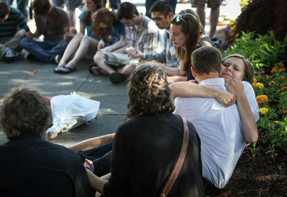Seattle Pacific University students gather outside of Otto Miller Hall to pray the day after a gunman shot three people on campus, killing one. Many on the campus of the Christian school have turned to prayer and their campus community during the tragedy. Photographed on Friday, June 6, 2014. Photo: JOSHUA TRUJILLO, SEATTLEPI.COM / SEATTLEPI.COM