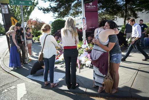Seattle Pacific University students gather at a growing memorial the day after a gunman shot three people on campus, killing one. Photographed on Friday, June 6, 2014. Photo: JOSHUA TRUJILLO, SEATTLEPI.COM / SEATTLEPI.COM