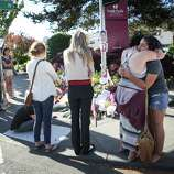 Seattle Pacific University students gather at a growing memorial the day after a gunman shot three people on campus, killing one. Photographed on Friday, June 6, 2014.