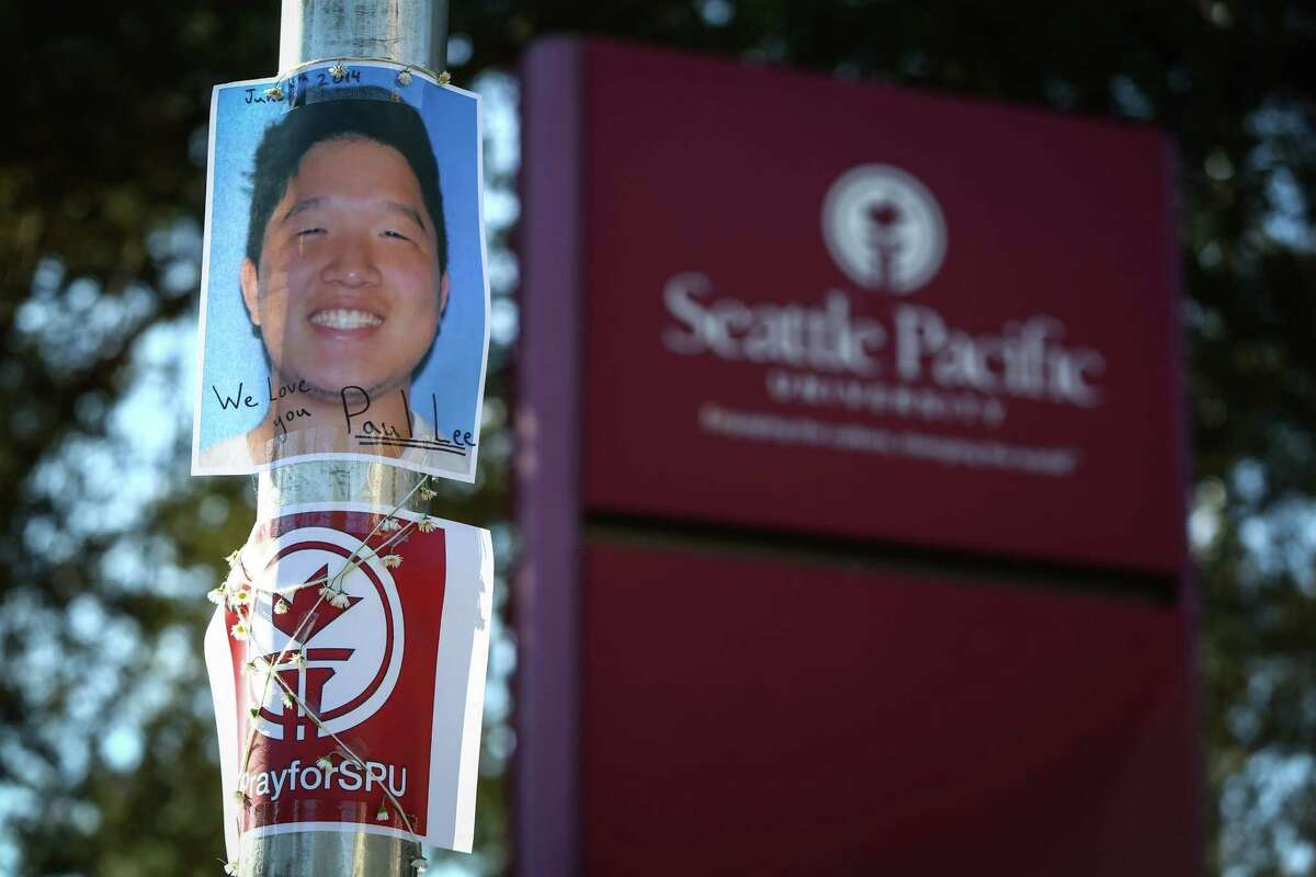 A photograph showing victim Paul Lee is taped to a pole outside of Otto Miller Hall at Seattle Pacific University the day after a gunman shot three people on campus, killing one. Photographed on Friday, June 6, 2014.
