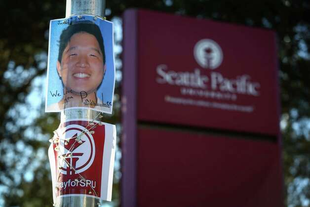 A photograph showing victim Paul Lee is taped to a pole outside of Otto Miller Hall at Seattle Pacific University the day after a gunman shot three people on campus, killing one. Photographed on Friday, June 6, 2014. Photo: JOSHUA TRUJILLO, SEATTLEPI.COM / SEATTLEPI.COM