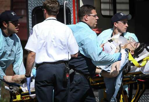 A shooting victim is removed from the scene at Seattle Pacific University after a gunman shot four people on campus, killing one. Photographed on Thursday, June 5, 2014. Photo: JOSHUA TRUJILLO, SEATTLEPI.COM / SEATTLEPI.COM
