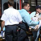 A shooting victim is removed from the scene at Seattle Pacific University after a gunman shot four people on campus, killing one. Photographed on Thursday, June 5, 2014.