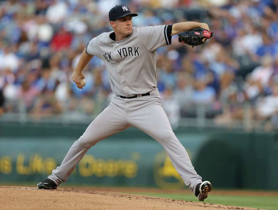 KANSAS CITY, MO - JUNE 6:  Chase Whitley #39 of the New York Yankees throws in the first inning against the Kansas City Royals at Kauffman Stadium on June 6, 2014 in Kansas City, Missouri. (Photo by Ed Zurga/Getty Images) ORG XMIT: 477584517 Photo: Ed Zurga / 2014 Getty Images