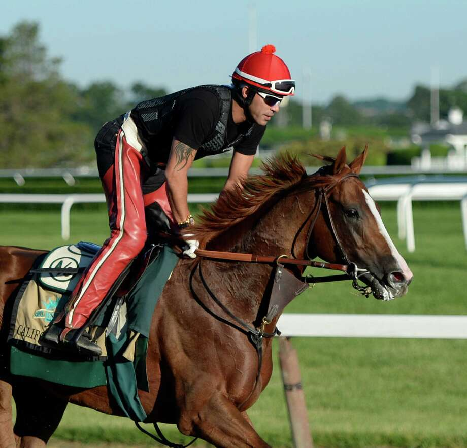 California Chrome gets his morning workout the day before he tries to race into horse racing lore at the Belmont Stakes. Photo: SKIP DICKSTEIN, STAFF PHOTOGRAPHER / ONLINE_YES