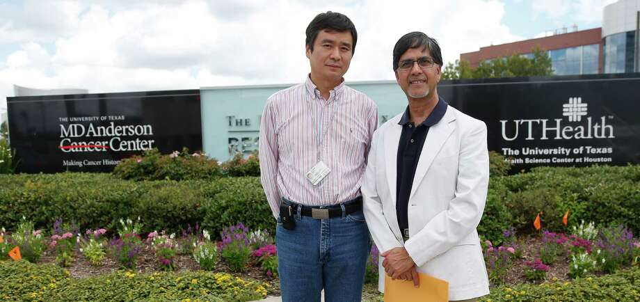 Zhengxin Wang, left, and Kapil Mehta are two M.D. Anderson Cancer Center professors whose tenure recently was denied. Photo: Karen Warren, Staff / © 2014 Houston Chronicle