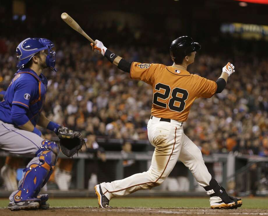 Buster Posey follows through on his decisive two-run homer off Mets reliever Carlos Torres with one out in the eighth. Photo: Ben Margot, Associated Press
