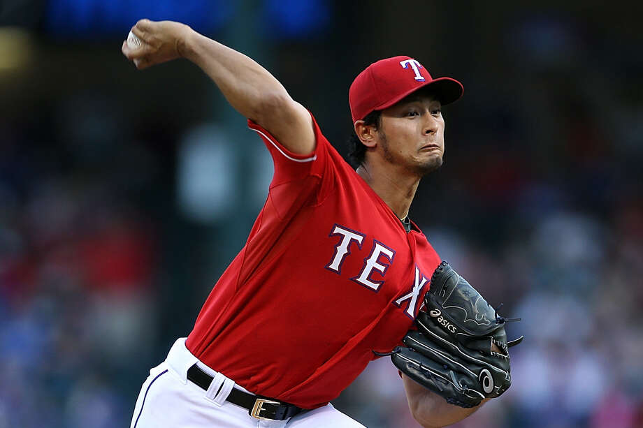 Yu Darvish blew a four-run lead and allowed a season-high nine hits in seven innings, but still won. Photo: Rick Yeatts / Getty Images / 2014 Getty Images