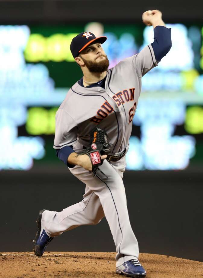 Dallas Keuchel throws in the first inning. Photo: Jim Mone, Associated Press
