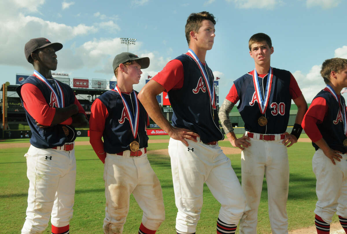 Atascocita Eagles Joseph Anderson, from left, Timothy Robison, Travis Jones, and Adam Petersen wear their medals after their 5-4 loss to San Antonio Reagan in their Class 5A 2014 UIL Baseball State Championships semifinal matchup at Dell Diamond in Round Rock on Friday.