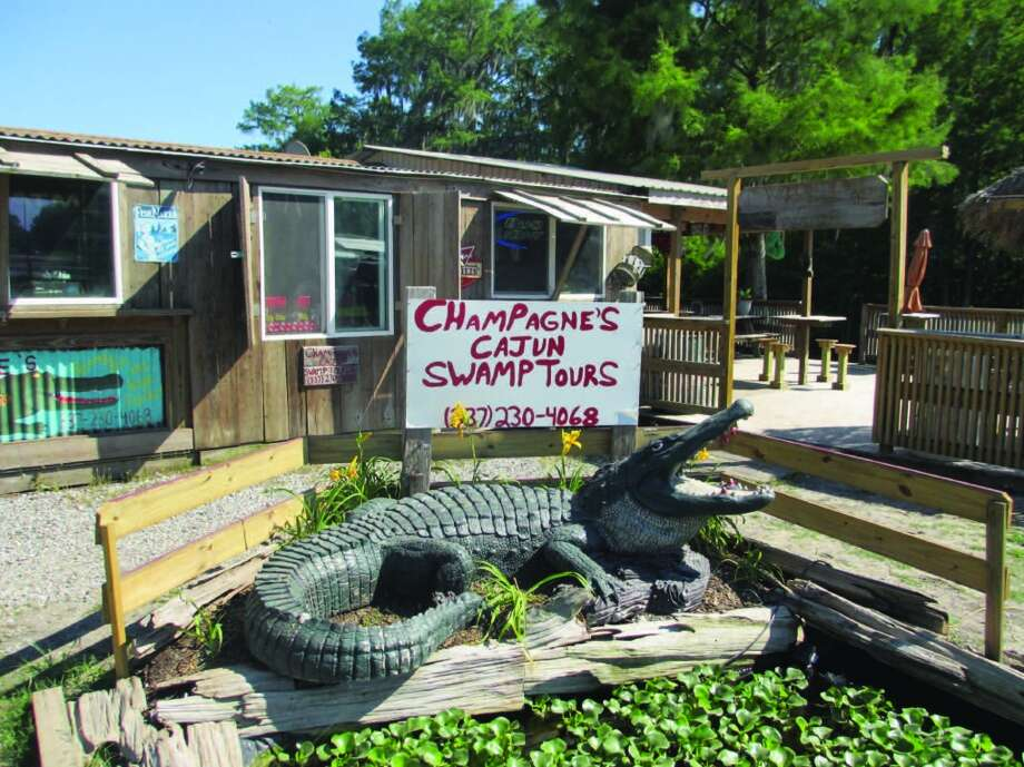 The office for Champagne's Cajun Swamp Tours on Lake Martin is a bit rustic, with a big man-made alligator to attract the curious. Photo: Terry Scott Bertling, San Antonio Express-News