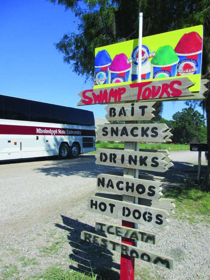 A sign in front of the Champagne's Cajun Swamp Tours office advertises snacks. The Mississippi State softball team's bus was parked nearby while the team and coach went on a swamp tour. Photo: Frank Bertling, For The Express-News
