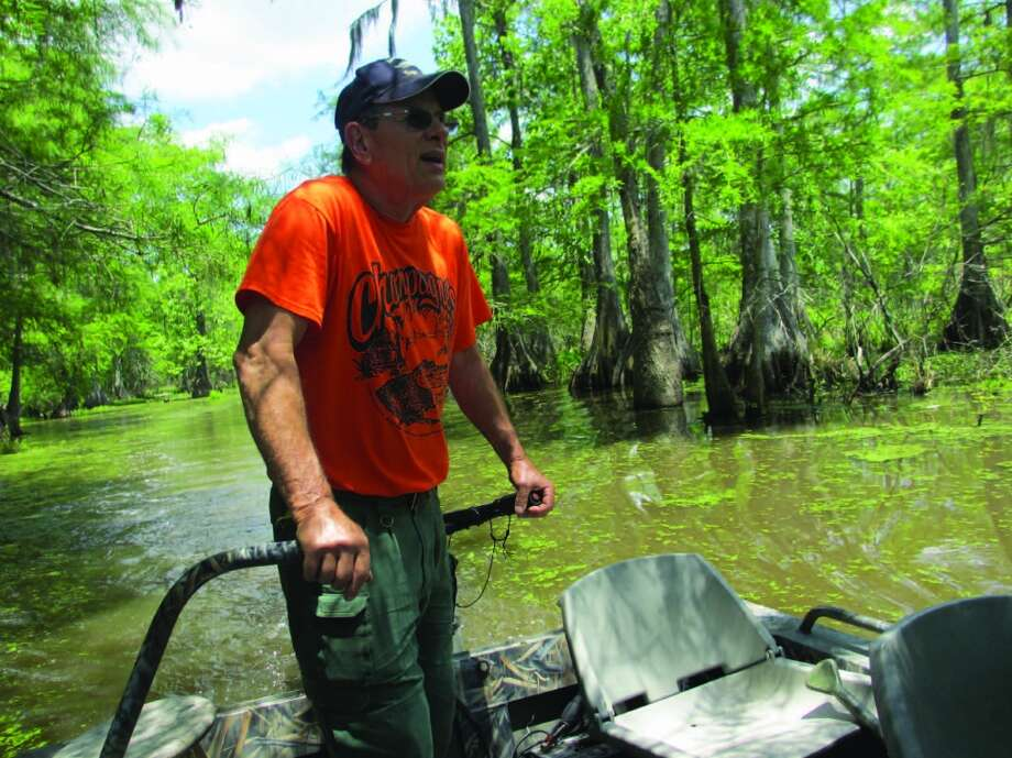 "Lawrence DeBlanc, our tour guide, called himself ""Lawrence of the Swamp."" When he's not working as a swamp tour guide, he's an ice carver. Photo: Terry Scott Bertling, San Antonio Express-News"