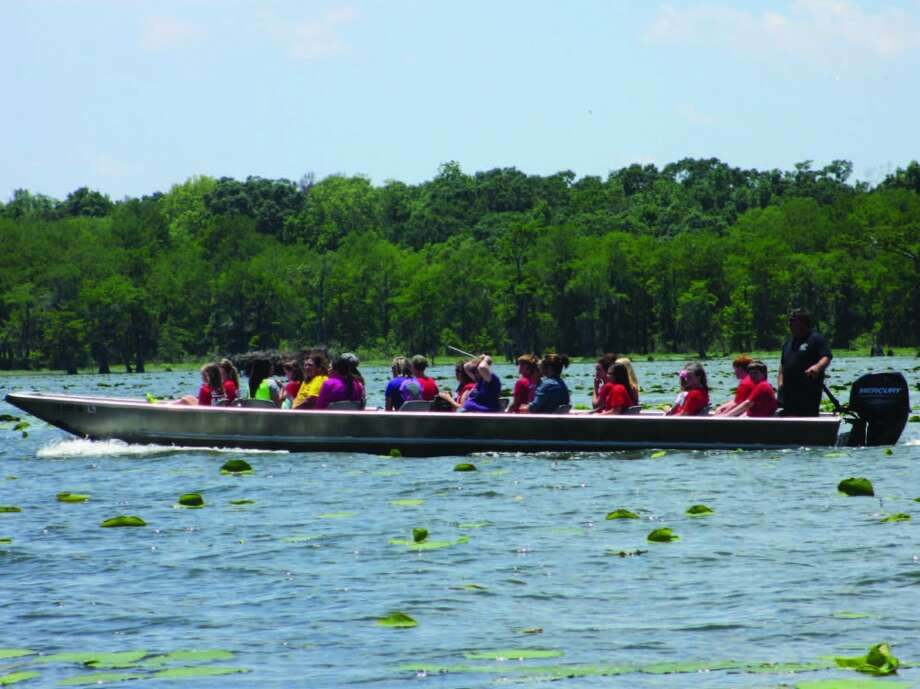 A swamp tour boat is loaded with young passengers on Lake Martin. Photo: Terry Scott Bertling, San Antonio Express-News
