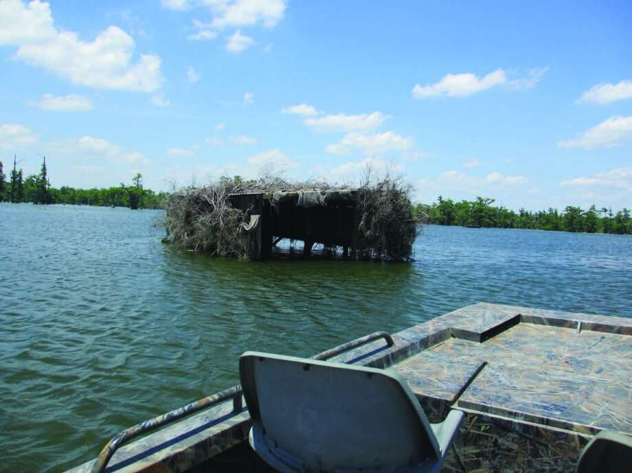 Elaborate duck blinds are scattered around Lake Martin. Photo: Frank Bertling, For The Express-News