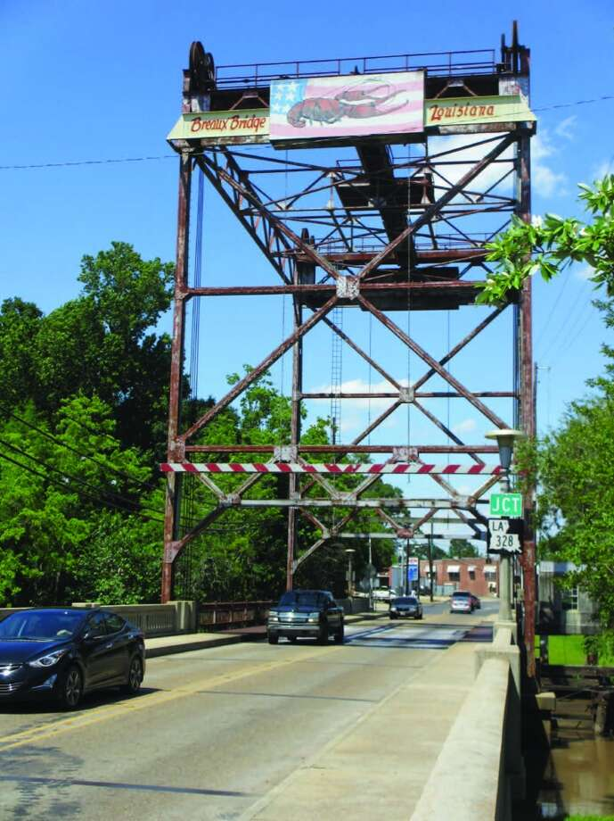 The sign on the tall structure in Breaux Bridge declares it the crawfish capital of the world. Photo: Frank Bertling, For The Express-News