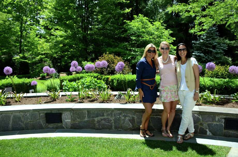 Sharon Libman, Chris Farley, and Julie Marcus enjoy the many beautiful features on the patio of the Silvermine Road home, during the New Canaan Nature Center's Secret Gardens Tour, Friday, June 6, 2014. Photo: Jeanna Petersen Shepard, Freelance Photo / New Canaan News freelance